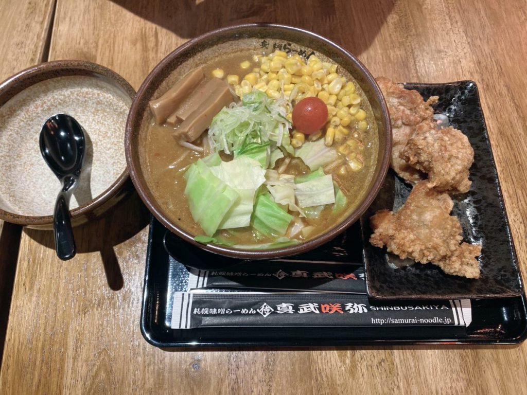 shinbusakiya miso ramen with a side of chicken